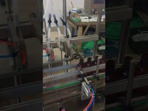 4 ראשים מכונת מילוי נוזל בקבוק קטנה