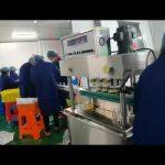 מכונת מילוי וכיפוי סיבובית